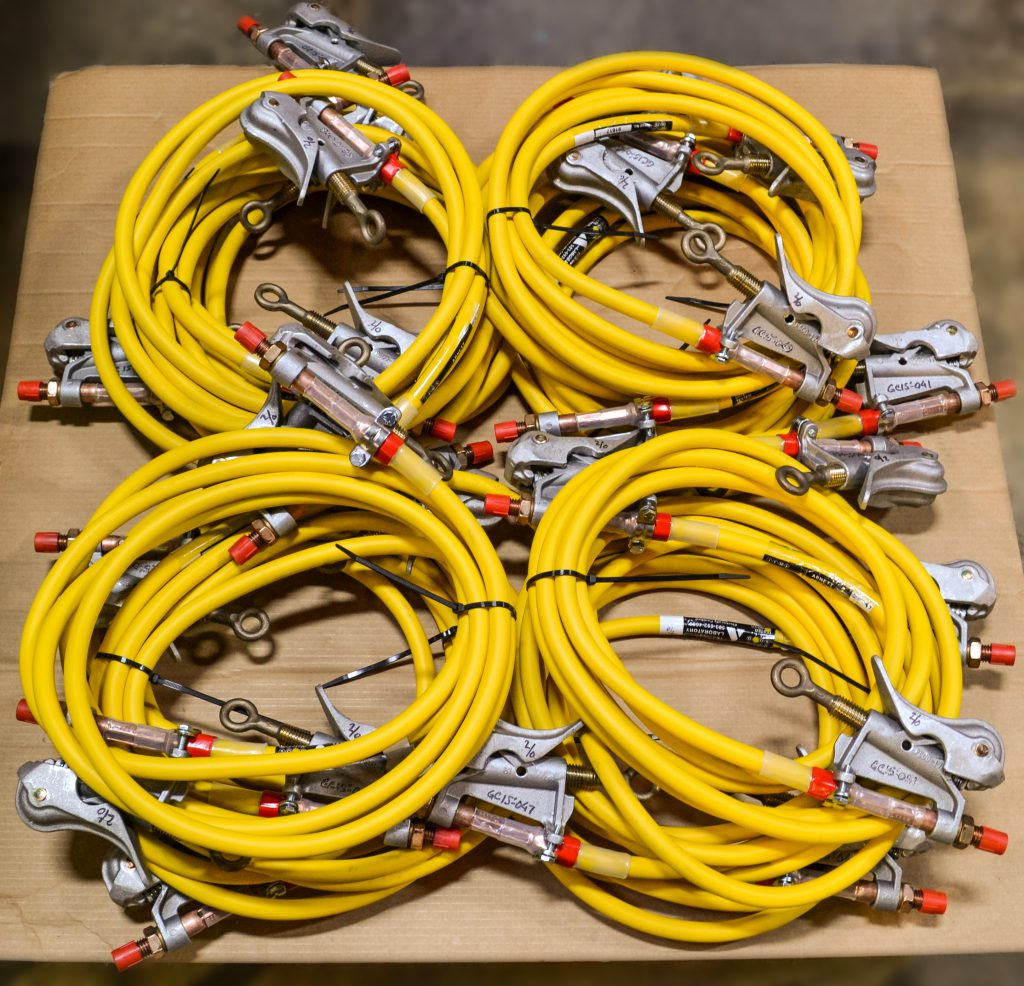 Custom grounding cable assembly with yellow 2/0 cable and duckbill clamps